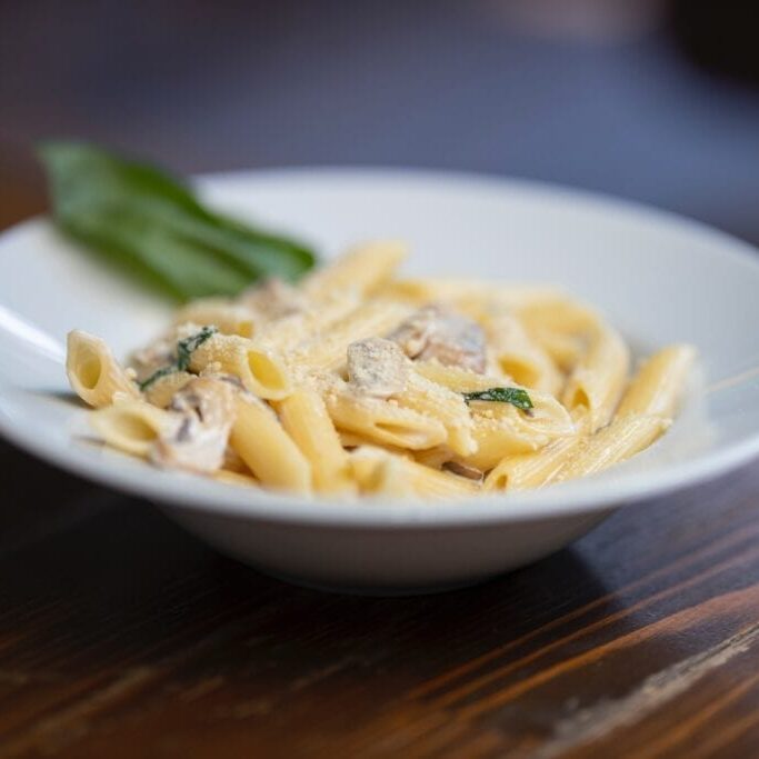 bowl-of-pasta-on-wooden-surface-3214159